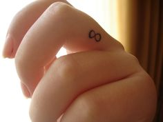 Infinite finger tattoo.