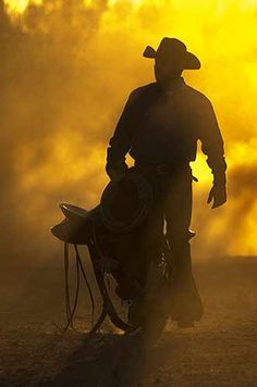 cowboy silhouette dusty sunset love