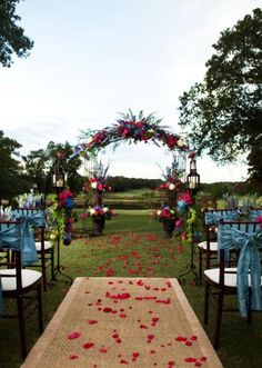 Beautiful outdoor altar by Signature Flowers. Photo by Artworks Tulsa Photography. #wedding #altar #red #blue