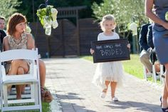 'Here Come the Brides' sign at same-sex wedding.