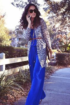 EVILTWIN Leopard print open cardigan: Available at TUNI Boutique $115 | Silver/Gold Chain Blue Jumpsuit by SUZI O.: Available at LIZ'S FASHION EXPERIENCE $185 | JJWINTERS Brown Large Envelope Clutch: Available at LIZ'S FASHION EXPERIENCE | PAIGE NOVICK Necklace