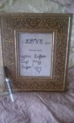 """Daily love reminder dry erase board for the bride and groom!  I made this using a picture frame and I printed the words on a pretty piece of paper.  I placed it in the frame and tied a dry erase marker with twine to the frame.  The message I wrote """"you light up my life"""" can be erased with the simple swipe of the bride or grooms hand and they can leave surprise love messages for each other.  I too have one of these for my husband and I.  We keep it in our walk in closet... nice daily messages!"""