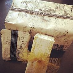 DIY Wrapping paper - leftover shipping paper, bubble wrap, paint.  For ribbons, cut up fruit/veggie bags.