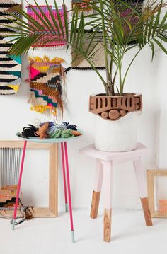 Love those bright colored textiles on the wall