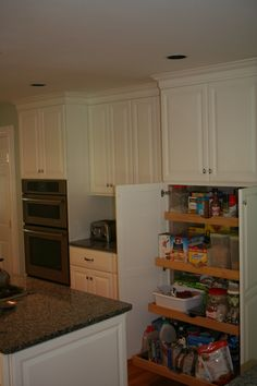 Candlelight Cabinetry Pull out pantry unit #RhodeIslandKitchen