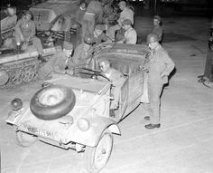 Allied forces checking out a Kubelwagen