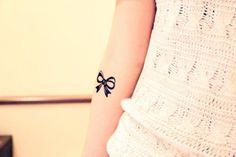 little bow tattoo