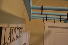 Hanging ladder = extra clothes storage or laundry room hanger. Need this, no closet space!