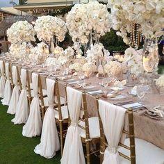 Opulence and elegance.  Love, love, love the chair sash.