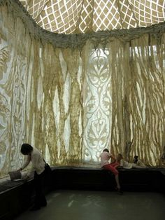 Palace Yurt by fiber artist Janice Arnold. She used the technique of felting wool fibers through sheer drapey silk fabrics for a translucent ethereal result. This technique is sometimes referred to as nuno felting.