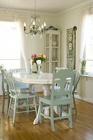 plane and paint the kitchen table white. Paint all the chairs seafoam green