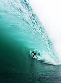 surfing tubes in turquoise waters