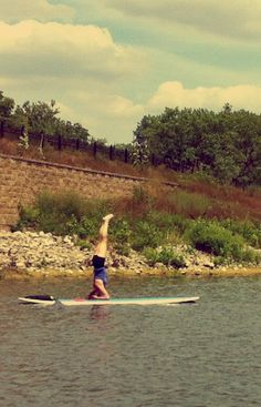 Stand up paddle board yoga headstand