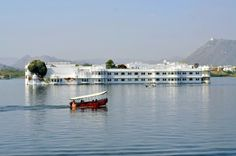 Boat on the lake near a palace in Udaipur, India. #india #incredibleindia #udaipur