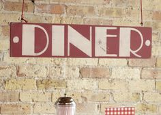 Diner Signage. Welcome guests to the baby shower with an inviting announcement at the entrance.