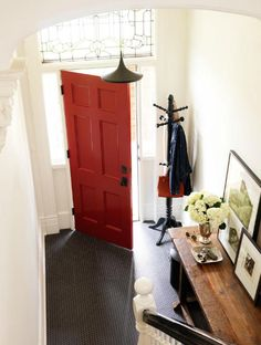 This red front door adds charm to welcome visitors.