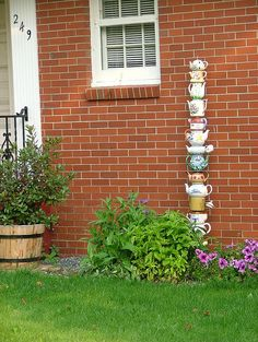 Teapots in the Garden, now I won't be able to pass up the cute tea pots in the thrift stores anymore!