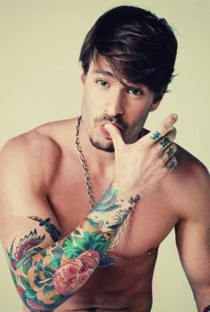 Don't know about the tattoo.. But that guy is cute! Colorful tattoos for guys