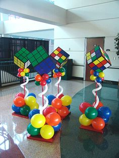 rubric cube centerpiece | We took this 80′s theme over the top with these totally awesome ...
