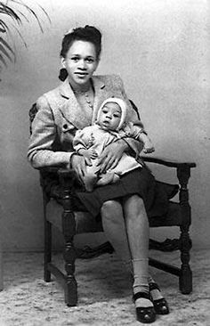 Baby Jimi Hendrix in his mother's lap