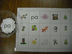 student grabs a syllable card, reads it aloud, and finds the picture that begins with that syllable