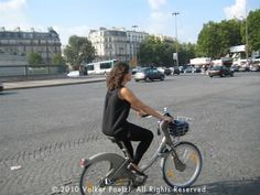 How to Bike in Paris! A How-to Guide. Biking in Paris on the Place de la Bastille via @TransAbroad