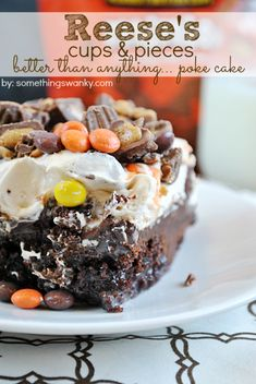 It's BTS cake revisted in Reese's form! Chocolate cake, topped with PB Chocolate ganache, smothered in PB whipped cream, and topped with Reese's Pieces and PB Cups | www.somethingswanky.com