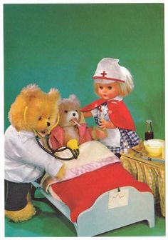 Vintage childrens postcard, doll nurse helping out the teddy bear doctor with a sick hospital patient.