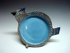 Shoshona Snow - I adore her pottery. I have several pieces.