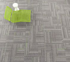 Rhythmic lines pulsate across Milliken's Backbeat collection, a series of chicly modern modular carpet tiles. Shown in Slam with Apple, a pattern from the Remix 2.0 collection.