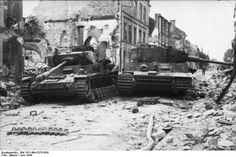 Abandoned Panzer VI and Tiger in Villers Bocage, France, summer 1944. Hitler's decision not to deploy his armor reserves on D-day robbed German forces of key support that could have made a difference in the fighting to block the path of Allied advance.