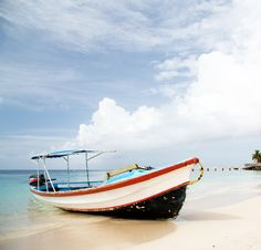 Spend the day seaside in Roatan, Honduras.