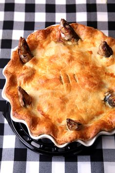 Stargazy Pie (English Sardine Pie) filled with bacon, hard-boiled eggs, and a mustard-laced custard