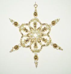 Beaded Snowflake - White Pearl and Gold - Ornament - Suncatcher - Decoration. via Etsy.