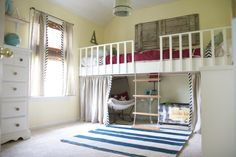 This makes me want to get rid of our nice bunk beds and build this loft idea instead!  Practical and adorable.