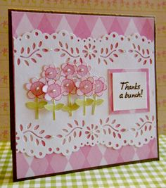 """Pretty pink flowers popping off the page will say """"thanks a bunch"""" in a springy way!  These tall flowers were punched and then cut out for placement on the card front.  Martha Stewart Deep Edge Floral Vine border punch was used to create the delicate edging on this handmade thank you card."""