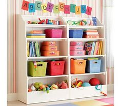 Great way to organize a kids room! I should add a piece of wood to the bottom of our ikea shelves to store toys, like the bottom of this shelf.