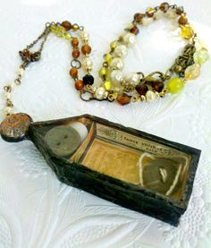 "Love this ""Joseph Cornell"" styel assemblage art box disguised as a necklace!  Seamstress Rosary Sewing Notions by Mystarrrs on Etsy."