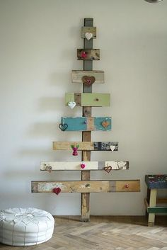 Doin this!!!! Putting little pegs so I can still hang my ornaments!!!  wood christmas tree :: maybe to display Christmas Cards. - love this idea