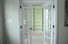 WALK-IN CLOSET: Bookshelves made to look built-in for shoes and other accessories