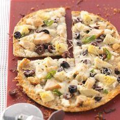 Greek Pizza - With artichokes, feta cheese, Greek olives and herbs on a crispy flatbread crust