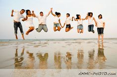 family beach photography - can everyone jump at the same time?!  Love it