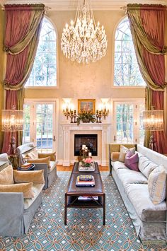 Grandiose statement! Multiple swags are a good solution for these tall ceilings and arched windows.