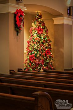 Christmas Tree elegantly decorated with Poinsettias and crushed red velvet bows for a sanctuary.