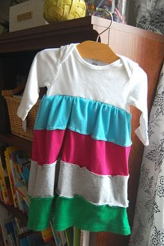 A onsie and some old T-shirts into a baby dress