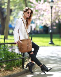 Spring State of Mind: Lauren of The Marcy Stop takes a moment of spring solace in our Becky Jacket and carrying our Logan Messenger.