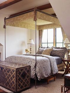 old world country bedroom with damask canopy and blue bedding