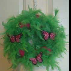 Spring wreath made with feather boa, ribbon and butterflies