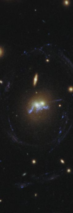 """10 Jul 2014: NASA's Hubble Space Telescope has spotted a strange celestial """"string of pearls"""" wrapped around the hearts of two merging elliptical galaxies... Rarely seen merger drips-new stars like beads on a string.. (more pics and video at link)"""