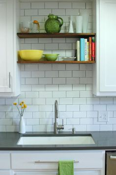 Love the shelves above the sink, if it couldn't be at an exterior wall.